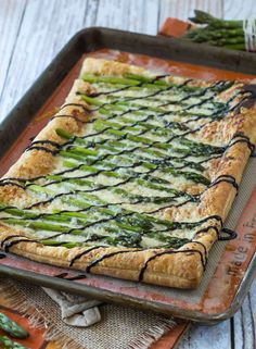 Perfect for spring, this asparagus gruyere tart is a show-stopping addition to any brunch or appetizer table. You won't believe how easy it is to make! Get the recipe on RachelCooks.com! #sponsored @Milk Means More