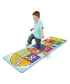 Little ones can leap forward in learning with this colorful hopscotch rug that transforms the classic game into educational décor. A reinforced border prevents fraying and skid-proof backing is safe on surfaces.
