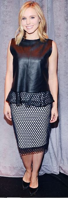 Who made Kristen Bell's black leather top, black pumps, and print white skirt?
