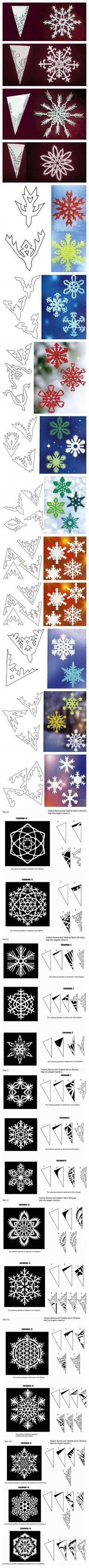 Heel veel verschillende sneeuwvlokken van papier.