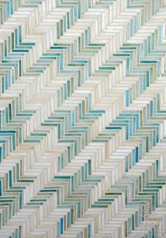 Houndstooth, a hand cut jewel glass mosaic shown in Aquamarine and Quartz, is part of the Houndstooth Collection by Sara Baldwin for New Rav...