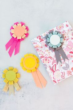 Everyone is a winner with these prize ribbon gift toppers! With pretty pastels and floral prints, the wrapping is a present all on its own!