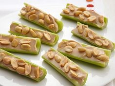 Nutritious and delicious! Nutty Celery Snacks with peanuts. Celery Snacks, Celery Recipes, Nut Recipes, Peanut Butter Recipes, Kraft Recipes, Recipes Appetizers And Snacks, Yummy Snacks, Snack Recipes, Yummy Food