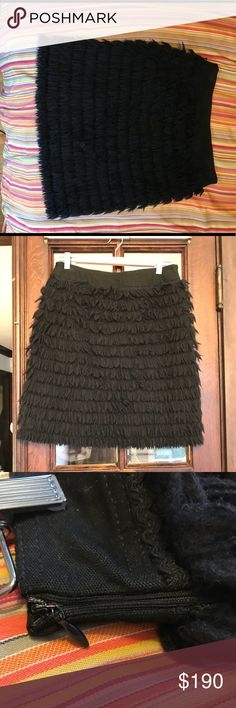 Fringe yarn mini skirt Moschino! Black jean mini skirt. Yarn fringe throughout and black on black rickrack detail. Adds volume and interest without being too bulky. Wash and wear! Moschino jeans brand. Marked size 8, would fit size 6 as well. I wore this over patterned tights. 14 inches across waist lying flat. Moschino Skirts Mini