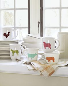 Colorful stenciled mugs