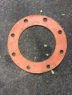 """At first glance, a rubber gasket. A closer look reveals the letter """"Q""""."""