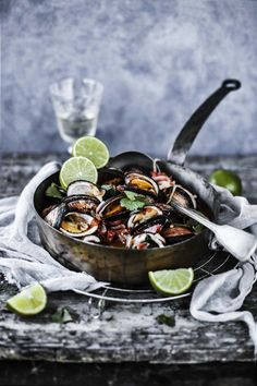 Clams in a tomato, bacon and coriander sauce.
