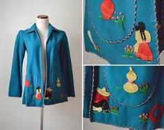 La Mexican vintage 1950s teal blue felt wool embroidered jacket. Labeled size 36/34, fits more like 32-33 in my opinon.Jacket is in great shape