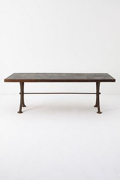 Dining room: a perfect table; large enough to entertain distressed enough to bear the burdens of a busy family.  Burnt Wood Dining Table, #anthropologie