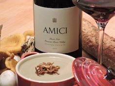 """""""Wild and Tame"""" Mushroom Soup with Crispy Shallots. Download this recipe at http://www.amicicellars.com/news_and_events/recipes/mushroom_soup.php Paired with Amici Cellars Pinot Noir, this soup makes a wonderful first course for a sophisticated dinner party.  The flavors of raspberries and black cherry in the wine provide a nice balance to the hint of cream in the soup, while the wine's subtle earthy notes harmonize beautifully with the soup's deep mushroom flavor."""