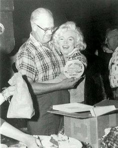 """Marilyn wearing her wool ski sweater on the set of """"Let's Make Love"""" ~ 1961"""