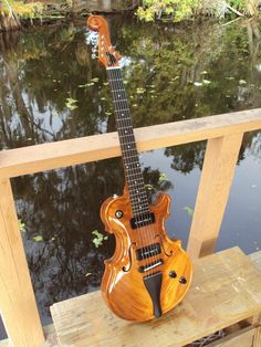 Scattervarius Guitar, a no-joke repurpose of the classic violin shape. cool, but it does not look like rock n roll.