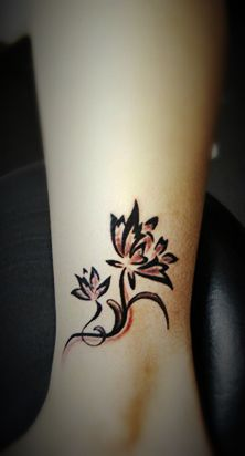 Lily tattoo on the leg #ankle #tattoo