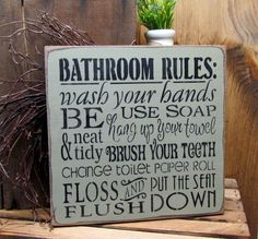 "This wood sign reads ""Bathroom Rules Wash Your Hands Use Soap Be Neat And Tidy Hang Up Your Towel Brush Your Teeth Change Toilet Paper Roll Floss Flush And Put"