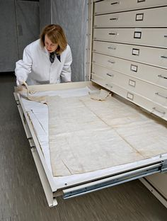 Linda Baumgarten, curator of textiles, examines a shift—body linen—in Colonial Williamsburg's collections.