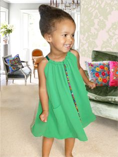 mia dress - emerald green halter neck dress with contrast green satin straps and back neck tie.  this style has a stunning indian pom pom trim which runs down the centre of the dress.  fabric : georgette with a contrast green chiffon lining.