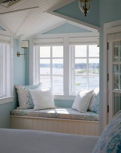 Pretty pastel blues echo the water view in this country cottage bedroom window seat...  Bedroom - traditional - bedroom - boston - by Polhemus Savery DaSilva