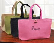Both fashion forward and earth friendly, our Rockport Totes are made of 100% natural jute and make excellent accessories for girls on the go!  Features and Facts:Color(s): Green,Black,Natural,PinkMaterials: 100% Natural Jute Details:The Rockport Tote may be embroidered with a script name (max of 12 characters) in white, light tan, sage, medium pink, red, navy, brown or black thread at no additional cost. Dimensions:Measures 19.5 inches wide by 10.25 inches tall and 5 inches deep.Packaging…