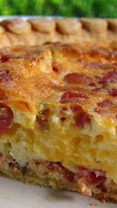 Cracked Out Quiche...1 9-inch deep dish pie crust, 3 oz cooked bacon pieces, 1 cup shredded cheddar cheese, 3 eggs, 1/4 cup milk (I used 1%), 1/4 cup heavy cream, 1/2 cup light Ranch dressing.