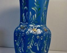A lighter blue crackle glass vintage vase, hand painted in a Scandinavian style design of garden daisies, using acrylic enamel paint. Blue Glass Vase, Crackle Glass, Hand Painted, Trending Outfits, Unique Jewelry, Handmade Gifts, Painting, Etsy, Vintage
