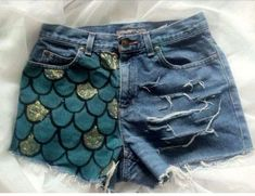 Make your own mermaid shorts! #DIY and paint mermaid scales on an old pair of blue jean shorts. #DIY #MermaidFashion