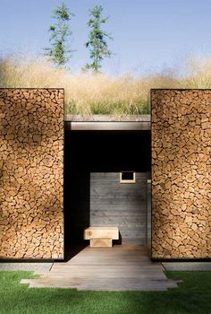 Exterior walls fashioned of stacked wood in steel frames at Stone Creek Camp, located on Flathead Lake in Bigfork, Montana. Designed by Austin, Texas-based Andersson Wise Architects. Design Exterior, Facade Design, Wall Exterior, Exterior Doors, Exterior Cladding, Roof Design, Stone Creek, Stone Facade, Wood Facade