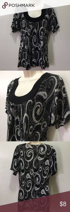 Ashley J Blouse Black and white top with sequins. Small spot in photo 4. 95% Polyester, 5% Spandex Ashley J Tops Blouses