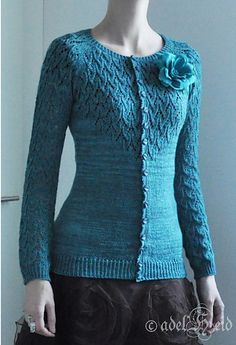 Elly is a fitted cardigan named after my Grandma. Sleeves and top of the front side is knitted in lace pattern and otherwise in stockinette. Knitted from top down and with several shaping alternatives to make it fit your own body type. Pattern includes shapings for the bust, waist, hips and a swayback.