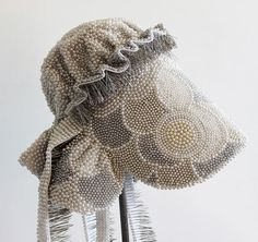 Angela Ellsworth Seer Bonnet XXI (Eliza)pearl corsage pins, fabric, steel, wood