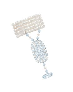 Hand ornament with a daisy motif in diamonds, cultured pearls and platinum. From The Great Gatsby collection by Tiffany & Co., inspired by Baz Luhrmann's film in collaboration with Catherine Martin.