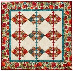 Red and turquoise combine beautifully in a wall hanging that features large floral prints and ample room for extensive quilting in spacious cream print setting squares.