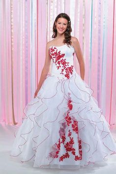 Usually quinceanera wears a bright color dress and the other couples wear long dresses (ladies) which are often brightly colored. They are never to overshadow the birthday girl's dress which is the main focal point of the celebration.