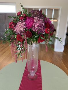 Bright pink peonies, hydrangeas, zinnias, hanging amaranthus, leucadendron, italian ruscus and more making this centerpiece absolutely fabulous! Let Holliday's design the arrangements for your next event!