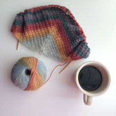 A simple shawl featuring diagonal lines, that works beautifully in either a variegated or semi-solid yarn.