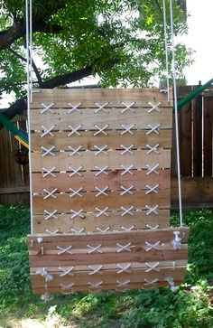 Hanging chair made from pallet wood or 1x4's and rope or twine. It would be cool to have a bunch of these hanging by the creek or a fire pit