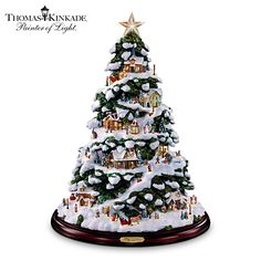 Thomas Kinkade Village Artificial Tabletop Christmas Tree - features 12 Victorian villages and over 40 villagers.  A beautiful wintry scene that's just the right size (15 inches) for a tabletop or centerpiece.