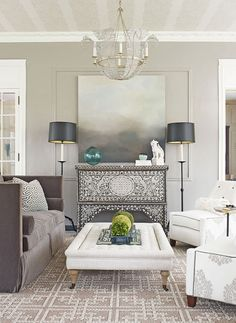 End of summer: couches facing table with mirror and dresser in silvers