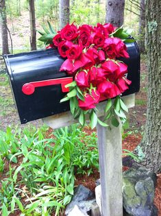 Blanket of Roses for Derby Party~I took a red mesh rubber matt, cut it to fit the mailbox; cut rosebuds short and stuck them in starting at the bottom, then added greenery.  Lasted for days!