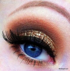Gold base with brown in the the crease. Winged liquid liner with false lashes. Line inside the waterline with white eyeliner and sweep brown shadow underneath