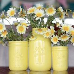 take your old jars and paint them. They turn into beautiful vases. Jars can be painted to blend with the floral arrangements being placed in them.