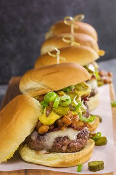 These are the ultimate sliders! Beef patties infused with whiskey and topped with baked beans, bacon, and cheese.