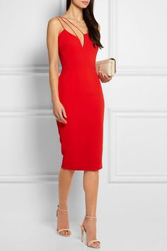 VICTORIA BECKHAM Crepe dress$1,995   Victoria Beckham's dress is crafted from smoothing red crepe to define your curves. This sleek style is designed with delicate asymmetric straps that frame the décolletage and the spliced front. The signature two-way zip through the back can be used to customize a slit.