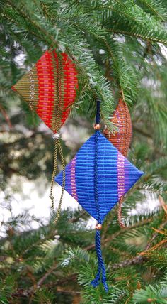 Holiday ornaments for anytime! These are woven on a small loom called an inkle loom. For me, the fun is in combining colors. They are woven in long narrow bands or strips and the weaver has to decide what to do with them. Some sew several together for a wider piece, some make belts or guitar straps. I chose to make tree ornaments. Mostly cotton with some metallic yarn Bead accents Approximately 3 square FREE SHIPPING