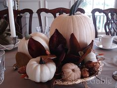 White pumpkin centerpiece on burlap with other brown accents.  Great way to use all sized pumpkins.