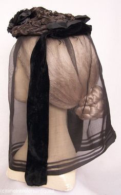 An original circa 1865 to 1875 lady's fanchon style woven horsehair and braided straw gimp mourning bonnet with a spray of black cloth flowers at the front. Silk velvet streamers, a silk drawstring lining with a wired buckram foundation, and a black silk mourning veil. ... from eBay ... photo 3