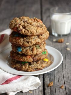 MONSTER COOKIES 3 eggs 1 1/4 cups packed light brown sugar 1 cup granulated sugar 1/2 teaspoon salt 1/2 teaspoon vanilla extract 1 12 -ounce jar creamy peanut butter 1 stick butter, softened 1/2 cup multi-colored chocolate candies 1/2 cup chocolate chips 1/4 cup raisins, optional rice krispies, optional 2 teaspoons baking soda 4 1/2 cups quick-cooking oatmeal (not instant)