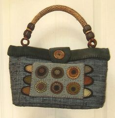 Primitive Folk Art Wool Applique Purse Pattern:  CIRCLE STAR Purses. $7.00, via Etsy.