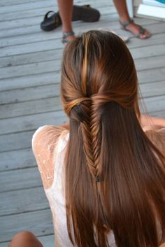 Love how only part of her hair is pulled back into a sleek fish tail braid. What gorgeous, silky hair!