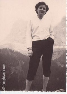 Mountain walking – 1957. Icon #5 wears pedal pushers (50′s-style calf-length trousers) probably high waisted and a white cardigan sweater. www.caughtwalk.com