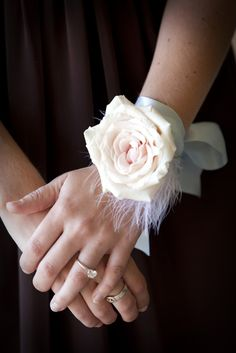 pretty wrist corsage (we don't have to use feathers but I like the large single bloom look for wrist corsages)